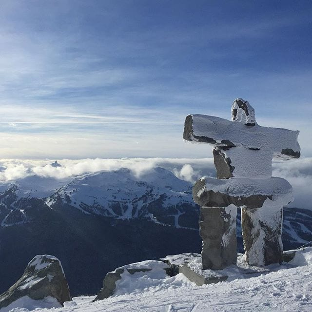 Inukshuk watches over Black Tusk sitting in Clouds